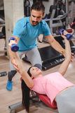 Trainer work with girl on chest flyes stock photo