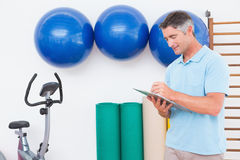 Trainer writing on clipboard Royalty Free Stock Image