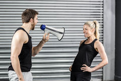 Trainer yelling through the megaphone Royalty Free Stock Photography