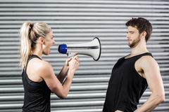Trainer yelling through the megaphone Stock Photo