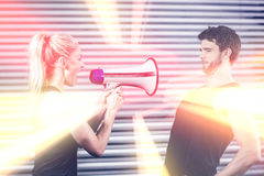 Trainer yelling through megaphone Stock Photography