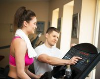 Trainer and young woman in fitness club Royalty Free Stock Photo