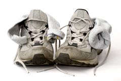 Trainers. Used trainers with socks on white background royalty free stock image