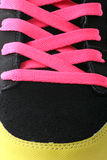 Trainers boot laces. Bright pink trainer shoe laces black, sports shoes royalty free stock photography