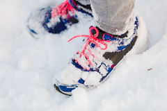 Trainers covered in snow. Female shoes outdoors. Fashion clothing nature outdoor concept royalty free stock photography