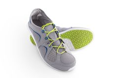 Trainers. Grey sport shoes isolated on the white background Royalty Free Stock Photo