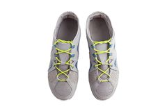 Trainers. Grey sport shoes isolated on the white background Stock Image