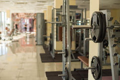 Trainers in gym hall. Royalty Free Stock Photography