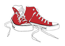 Trainers. Pair of red isolated trainers Royalty Free Stock Images
