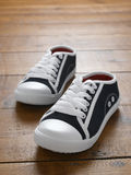 Trainers. Pair of sneakers on wooden floor Royalty Free Stock Images
