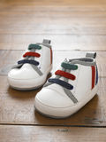 Trainers. Pair of sneakers on wooden floor Royalty Free Stock Photos