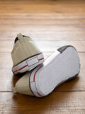 Trainers. Pair of sneakers on wooden floor Royalty Free Stock Photo