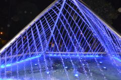 Traingle figure made of water lights in blue color stock images