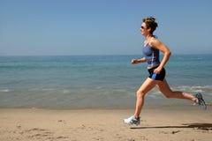 Trainieren auf dem Strand Stockbild