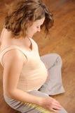 Trainieren der schwangeren Frau Stockfotos