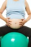 Trainieren der schwangeren Frau Lizenzfreie Stockfotos