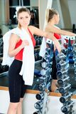 After training. Young sporty woman in the gym centre stock photo