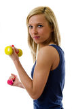 Training. Pretty blonde girl training with dumb-bells Stock Images