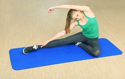 Training. Young sporty woman doing exercises in the gym centre royalty free stock image