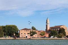 Training aerobatic aircraft of historic buildings on the coast of Venice Royalty Free Stock Photography