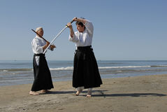 Training of Aikido on the beach Stock Photography