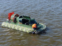 Training on the amphibious boat Slavir 636 to rescue a drowning person. Royalty Free Stock Image