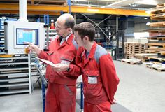 Training and apprenticeship in industry. Group of workers - closeup photo stock photography
