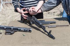 Training assembly of weapons for the reconstruction of the fighting of the Second World War. 2018-04-30 The Samara stock photography