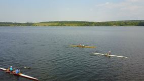 Training Athlete In Kayak. Training of small sportsmen rowers on a kayak on the river stock footage