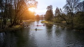 Training athletes kayakers on the rowing channel royalty free stock photo