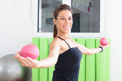 Training with balls. Girl doing pilates in studio royalty free stock photography