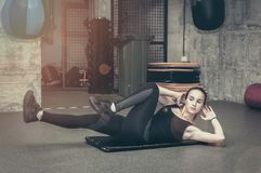 Training of beautiful attractive young girl workout abs muscles in the boxing gym royalty free stock photo