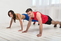 Training. Beautiful girl and handsome guy workout stock images