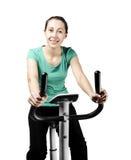 Training on bike exerciser Royalty Free Stock Images