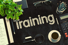 Training on Black Chalkboard. 3D Rendering. Stock Photos