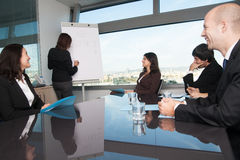 Training in board room. Business people smiling during training in board room Royalty Free Stock Photo
