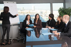 Training in board room. Business people talking during training in board room Royalty Free Stock Photography