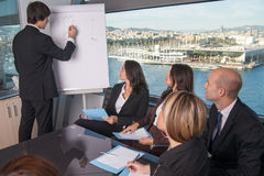 Training in board room. Business people talking during meeting in board room Stock Photography
