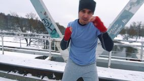 Training boxer on the bridge in winter slow mo. HD stock footage