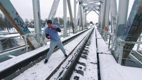 Training boxer on the bridge in winter. Training boxer fighter on the bridge in winter stock video footage