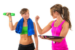 Training By Female Personal Coach Royalty Free Stock Photography