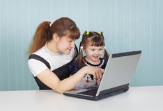 Training of child to work on computer in game form Royalty Free Stock Image