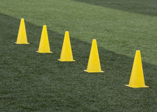 Training cones. Yellow training cones on a training pitch Royalty Free Stock Image
