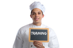 Training cook apprentice trainee cooking job young isolated. On a white background royalty free stock photography