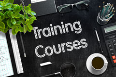Training Courses on Black Chalkboard. 3D Rendering. Stock Images
