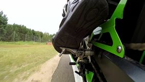 Training day on superbike circuit. Camera mount on rear control arm. ZIELONA GORA - AUGUST 16: Training bike day on Kawasaki Ninja ZX6-RR before motorcycling stock video