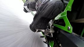 Training day on superbike circuit. Camera mount on rear control arm. ZIELONA GORA - AUGUST 16: Training bike day on Kawasaki Ninja ZX6-RR before motorcycling stock video footage