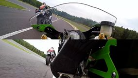 Training day on superbike circuit. Camera split screen. ZIELONA GORA - AUGUST 16: Training bike day on Kawasaki Ninja ZX6-RR before motorcycling tournament at stock video footage