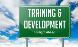 Training and Development on Highway Signpost. Royalty Free Stock Image