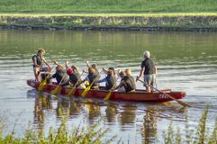 Training dragon boats on the river royalty free stock photo